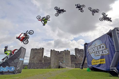 RIDING HIGH: Nitro World Games bikers jump beside Caerphilly Castle, Wales. The images are a composite of numerous frames blended together of motorbike riders in the air. Photographs: Ben Birchall/PA Wire