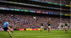Dean Rock kicks a free wide at the death during the All-Ireland SFC final. Photo:  Stephen McCarthy/Sportsfile
