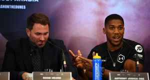 "Anthony Joshua and promoter Eddie Hearn at a promotional press conference for the ""Clash on the Dunes"" fight against Mexican-US WBA, IBF, WBO and IBO heavyweight boxing champion Andy Ruiz Jr. Photo: Daniel Leal-Olivas/Getty Images"