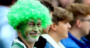 An Ireland fan at the Wales game in the Aviva  on September 7th. It is estimated that around 12,000 fans will travel from Ireland at various junctures of the World Cup, and that number will potentially be swelled to double that by the Irish diaspora.  Photograph: James Crombie/Inpho