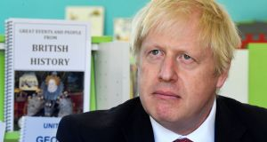 Britain's prime minister Boris Johnson during a visit to a London primary school. Photograph: Toby Melville/AFP/Getty Images
