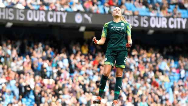 Manchester City goalkeeper Ellie Roebuck celebrates after her team scored against Manchester United at Etihad Stadium in the Women's Super League. Photograph: George Wood/Getty Images