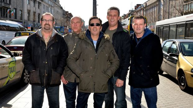 Joe Jewell, Alan Downey, Christy Dignam, Rodney O'Brien and Billy McGuinness of Aslan in O'Connell Street, Dublin in March 2014 after announcing a return to playing live. Photograph: David Sleator/The Irish Times