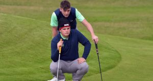 Ireland's James Sugrue and Robert Brazill  lining up their putt on the  9th green during day one of the 2019 Home Internationals  at Lahinch Golf Club. Photograph: Pat Cashman