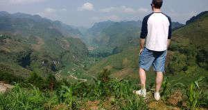 Gavin Brennan taking a break from running on the mountains around Hanoi.