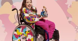 Izzy Keane with one of the new barbie dolls and their Izzy x Barbie wheelchair