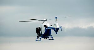 A Garda helicopter and up to 60 officers have been involved in a major search operation in Cork in which three men suspected of being involved in a number of burglaries and attempted burglaries are being pursued. File photograph: Stephen Collins/Collins.