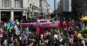 Extinction Rebellion in Oxford Street and Regent Street in London in April. The group is poised to scare the fashion industry into action.  Photograph: Daniel Leal-Olivas/AFP