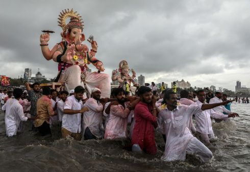 HINDU FESTIVAL: Devotees carry idols of Hindu god Lord Ganesha for immersion into the Arabian Sea, as part of a ritual of the Ganpati festival in Mumbai, India. Photograph: Divyakant Solanki/EPA