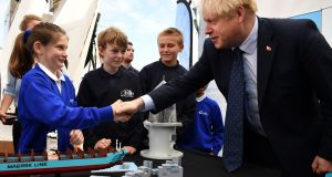 UK prime minister Boris Johnson takes part in an activity with schoolchildren in London. Photograph: Daniel Leal-Olivas/PA Wire
