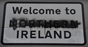 A defaced 'Welcome to Northern Ireland' sign is displayed on the Irish Border in Derry. Photograph: Charles McQuillan/Getty Images