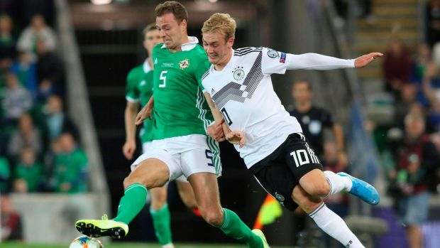Northern Ireland defender Jonny Evans and Germany midfielder Julian Brandt. Photograph: Paul Faith/AFP/Getty