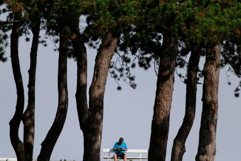 ENJOY THE SILENCE: Taking a break on a bench in the Phoenix Park, Dublin.  Photograph: Nick Bradshaw