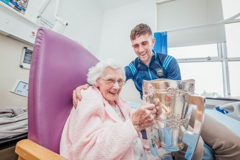 MY HERO: Tipperary hurler Barry Heffernan with his grandmother Mary McLoughlin as the All-Ireland champions visited the patients of Nenagh hospital. Photograph: Brian Arthur