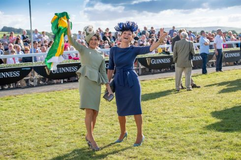 LADIES' DAY: Mary Kelleher from Killorglin with judge Celia Holman Lee after being named the best dressed lady at Listowel races. Photograph: Domnick Walsh/Eye Focus