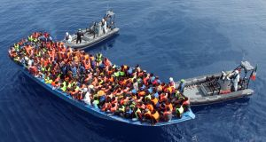 Irish Naval Service personnel helping migrants at sea in the southern Mediterranean between Italy and Libya. Photograph: Defence Forces