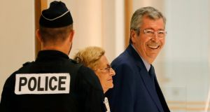 Mayor of Levallois-Perret Patrick Balkany  and his wife  Isabelle Balkany arrive at  a Paris courthouse on Friday. Photograph: Thomas Samson/AFP/Getty Images