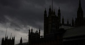 Dark clouds over the Houses of Parliament in London. File photograph: Will Oliver/EPA