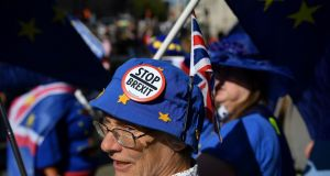 Anti-Brexit activists wave EU flags whilst draped in Union flags as they demonstrate outside the Houses of Parliament in London on Thursday. Photograph: Getty Images