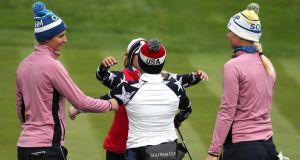 The United States pair of  Marina Alex and Morgan Pressel  celebrate beating  Europe's Anne Van Dam (left) and Anna Nordqvist  in their foursomes match on day two of the 2019 Solheim Cup at Gleneagles Golf Club in Auchterarder, Scotland.  Photograph: Jane Barlow/PA Wire