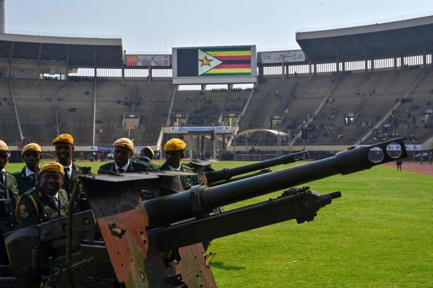 Zimbabwe soldiers prepare ceremonial canons to be used in rendering a gun salute, at the funeral. Photograph: Tony Karumba/AFP/Getty