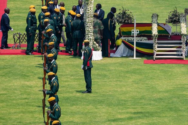 The coffin of Robert Mugabe is displayed during the funeral ceremony in Harare. Photograph: Photograph: Jekesai Njikizana/AFP/Getty