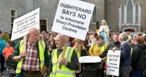 People gather for a silent protest march at Oughterard, Co Galway on Saturday in response to plans for the placing  of a direct provision in a disused hotel in the town. Photograph: Joe O'Shaughnessy.