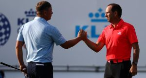 England's Callum Shinkwin shakes hands with Sergio Garcia  of Spain on the the 18th green after completing the third round  of the KLM Open at The International Golf Course  in Badhoevedorp, Netherlands. Photograph: Dean Mouhtaropoulos/Getty Images