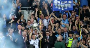 Dublin's Stephen Cluxton lifts the Sam Maguire Cup. Photograph: Billy Stickland/Inpho
