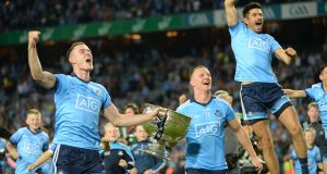 Brian Fenton, Ciarán Kilkenny and Cian O Sullivan celebrate Dublin's victory over Kerry in the All-Ireland final replay at Croke park. Photograph:  Dara Mac Dónaill