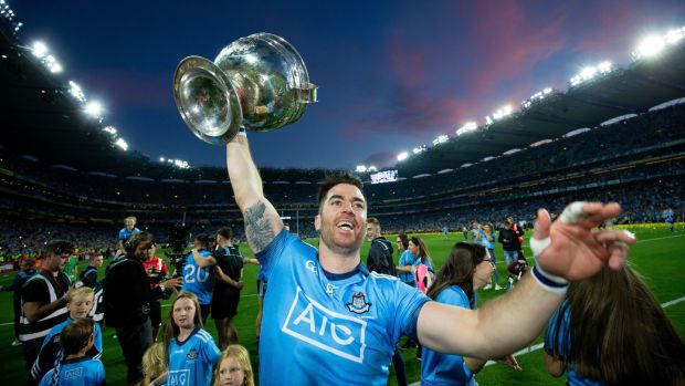 Dublin's Michael Darragh Macauley with the Sam Maguire after the game. Photograph: Tom Honan