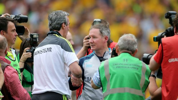 Jim McGuinness and Jim Gavin after Dublin's shock defeat in 2014. Photograph: Inpho