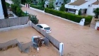 Spanish family trapped in attic by rising floodwaters