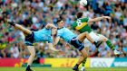 Dublin's James McCarthy and Brian Fenton challenge for the ball with Kerry's  David Moran during the All-Ireland football final replay at Croke park. Photograph: James Crombie/Inpho
