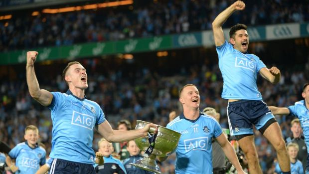Brian Fenton, Ciarán Kilkenny and Cian O Sullivan celebrate the victory over Kerry with the Sam Maguire trophy. Photograph: Dara Mac Dónaill