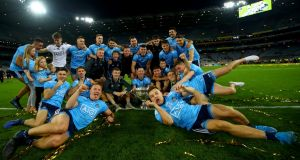 The Dublin team celebrates with the Sam Maguire cup. Photograph:  ©INPHO/James Crombie