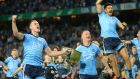 Brian Fenton, Ciaran Kilkenny and Cian O'Sullivan of Dublin celebrate beating Kerry in the All-Ireland football final. Photograph: Dara Mac Dónaill