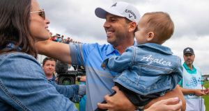 KLM Open champion  Sergio Garcia celebrates  with his wife Angie and  daughter Azalea, while his brother and caddie Victor looks on. Photograph:  Ronald Speijer/EPA