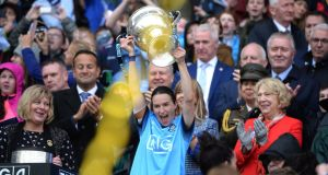 ANYTHING YOU CAN DO... Dubln captain Sinéad Ahern lifts the Brendan Martin Cup after beating Galway in the TG4 All-Ireland women's senior football championship final in Croke Park. Photograph: Dara Mac Dónaill
