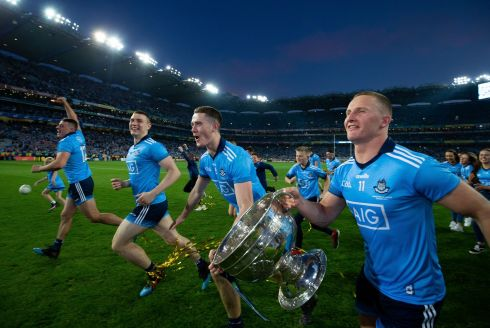 FIVE-IN-A-ROW: Dublin's Brian Fenton and Ciaran Kilkenny celebrate with the Sam Maguire after the All-Ireland football champions clinched the five-in-a-row with victory over Kerry at Croke Park. Photograph: Tom Honan