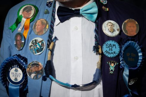 BADGE OF HONOUR: A Dublin fan all kitted out for the All-Ireland final replay against Kerry. Photograph: Tom Honan