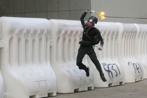 HONG KONG: A protester throws a Molotov cocktail during an anti-government rally in Hong Kong, China. Photograph: Vikesh Prakash/EPA