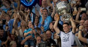 Dublin captain  Stephen Cluxton lifts the Sam Maguire after leading his side to a fifth consecutive All-Ireland victory. Photograph: Oisín Keniry/Inpho