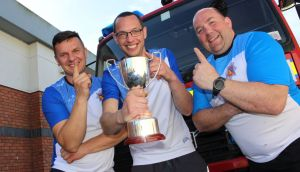 Rafal Gierasimiuk, Nigel O'Gorman and Marc Mulhaire from Thurles Fire Station – the overall winners of the Setanta Fire Service Games at the weekend. Photograph: Dylan Vaughan
