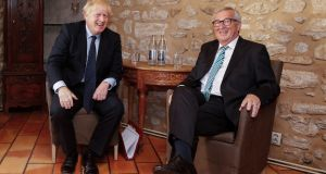 Acting European Commission president Jean-Claude Juncker (R) and British prime minister Boris Johnson (L) sit for a meeting in Luxembourg.  Photograph: Julien Warnand/EPA