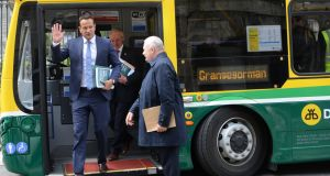 Taoiseach Leo Varadkar and Minister for Climate Action Richard Bruton, with other Ministers, arrive on a hybrid bus to announce details of the climate action plan at TU Dublin Grangegorman. Photograph: Dara MacDónaill