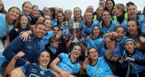 Dublin women celebrate their All-Ireland final win over Galway, which attracted a record crowd to Croke Park. Photograph: Bryan Keane/Inpho
