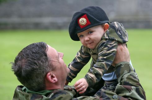 YOUNG RECRUIT: Cpl William Fitzmaurice of Athlone, with his son Noah (1), at Custume Barracks, Athlone, where the Minister with responsibility for Defence Paul Kehoe reviewed troops of the 60th Infantry Group ahead of their six-month deployment to Syria as part of the United Nations Disengagment Observer Force. Photograph: Colin Keegan/Collins Dublin