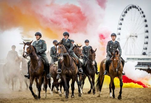 PRINCE'S DAY: Members of the Dutch honorary escort cavalry carry out rehearsals on the beach for Prinsjesdag (Prince's Day) in Scheveningen, Netherlands. The horses and riders are exposed to gunfire, cannon blasts, music and smoke to prepare them. Photograph: Koen Van Weel/EPA