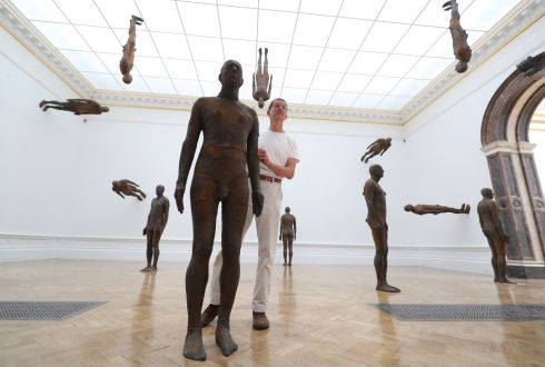 CLIMBING THE WALLS: British sculptor Antony Gormley poses with his installation of 24 figures, Lost Horizon I (2008), at a promotion of his major new exhibition at the Royal Academy of Arts in London. Photograph: Yui Mok/PA Wire